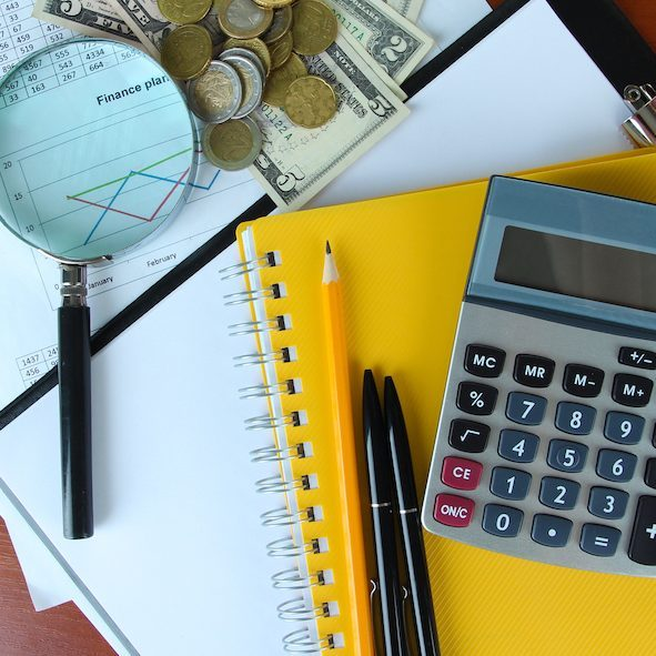 Office supplies with money and documents on wooden background